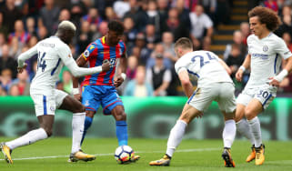 Crystal Palace forward Wilfried Zaha in action against Chelsea in the Premier League