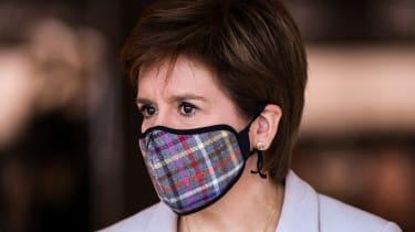 Nicola Sturgeon wearing a tartan print face mask.