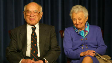 Milton Friedman pictured with his wife, Rose May, during a White House event in 2002