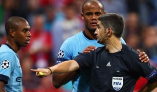 Fernandinho and Vincent Company of Manchester discuss with referee Alberto Undiano Mallenco during the UEFA Champions League