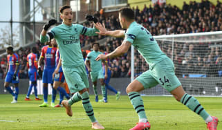 Mesut Ozil and Granit Xhaka celebrate a goal for Arsenal