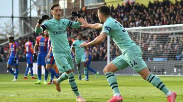 Mesut Ozil and Granit Xhaka celebrate a goal for Arsenal