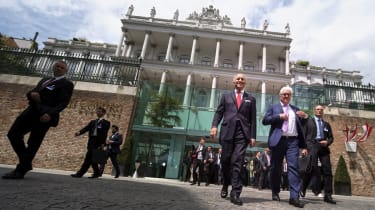 French Foreign Minister Laurent Fabius (L) and German Minister for Foreign Affairs Frank-Walter Steinmeier (R) arrives to address media outside of the Palais Coburg Hotel,where the Iran nucle