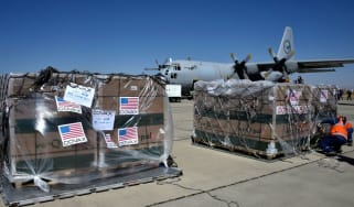 Shipment of Covid vaccines donated through Covax arrives at Bolivian Air Force base in El Alto