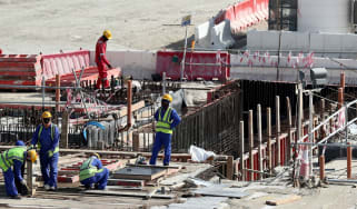 Workers at the construction site of the Al Bayt Stadium in Qatar