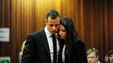 South African Paralympic athlete Oscar Pistorius with his sister Aimee on the thirteenth day of his trial for the murder of his girlfriend Reeva Steenkamp at the North Gauteng High Court in P