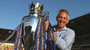 Gary Lineker poses with the Premier League trophy