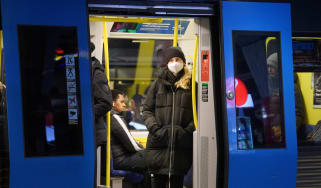 A passenger wearing a face mask on a subway train in Stockholm