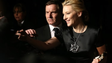 LONDON, ENGLAND - FEBRUARY 16:Cate Blanchett signs autographs as she attends an official dinner party after the EE British Academy Film Awards at The Grosvenor House Hotel on February 16, 201
