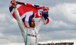 Mercedes driver Lewis Hamilton celebrates his win at the 2019 British Grand Prix