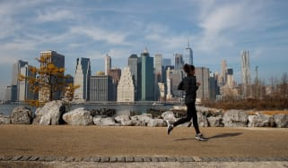 NEW YORK, NY - FEBRUARY 8: A jogger runs along the Brooklyn Bridge Park, February 8, 2017 in the Brooklyn borough of New York City. As temperatures touched 60 degrees on Wednesday, the city i