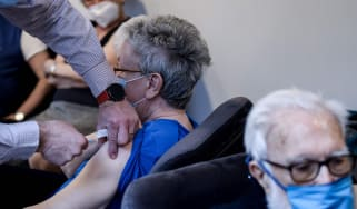 Residents at a care home in Belgium receive the Covid vaccine
