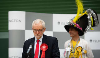 LONDON, ENGLAND - DECEMBER 13: Labour Party leader Jeremy Corbyn (L) speaks from the stage at Sobell leisure centre after retaining his parliamentary seat on December 13, 2019 in London, Engl