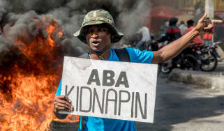 A Haitian man protests against rising gang violence on International Human Rights Day 2020