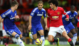 Marouane Fellaini of Manchester United competes with Gary Cahill of Chelsea