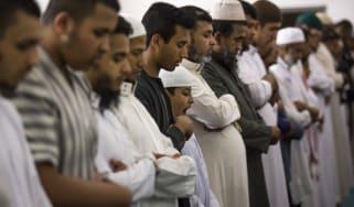 Muslim men pray during Ramadan in London
