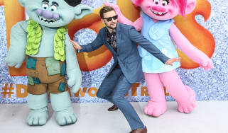 Justin Timberlake posing on the red carpet at Trolls Movie Premiere Sydney with characters Branch and Poppy.
