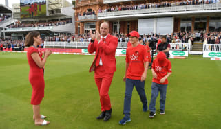 Andrew Strauss walks out at Lord's wearing red in memory of his late wife, Ruth