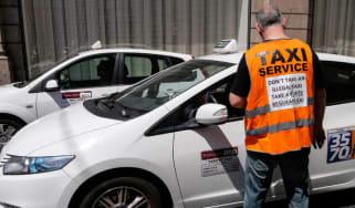 A local taxi driver protesting
