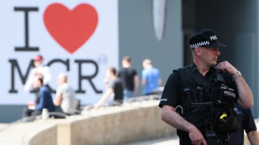 Armed police patrol the city centre ahead of a national minute's silence for victims of the Manchester arena attack