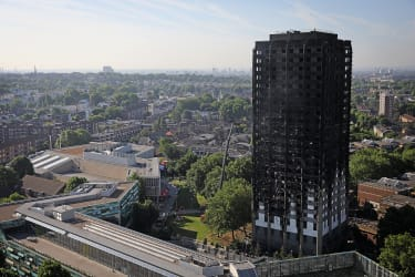 LONDON, ENGLAND - JUNE 15:Grenfall tower continues to smoulder on June 15, 2017 in London, England. At least twelve people have been confirmed dead and dozens missing after the 24 storey resi