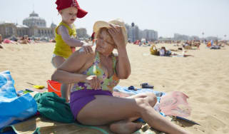 A woman and her grandchild applying sunblock
