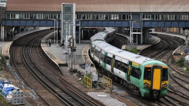 A Southern Rail train leaves Clapham Junction station in London