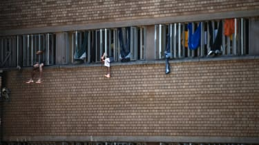 Inmates sit on the window of their cell in the Kgosi Mampuru II Prison where Oscar Pistorius spent part of his sentence, on December 1, 2015 in Pretoria.South Africa's Supreme Court of Appeal