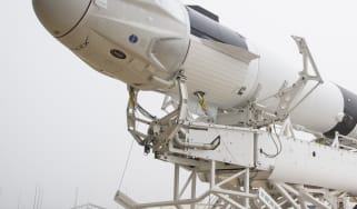 A SpaceX Falcon 9 rocket with the company's Crew Dragon spacecraft onboard is seen as it is rolled out of the horizontal integration facility at Launch Complex 39A as preparations continue fo