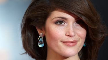 English actress Gemma Arterton poses for pictures on the red carpet upon arrival to attend the Lawrence Olivier Awards for theatre at the Royal Opera House in central London on April 13, 2014