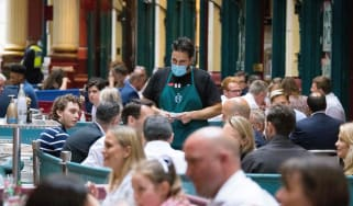 Waiter working in a London cafe