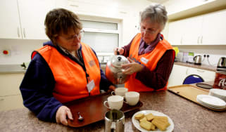 NORTH PETHERTON, UNITED KINGDOM - FEBRUARY 05:RVS volunteers Verity Trevor-Morgan and Marsha Casely make cups of tea at a rest centre that has been set up at North Petherton bowling club for