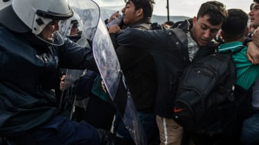 Refugees scuffle with riot police on the Greek island of Lesbos