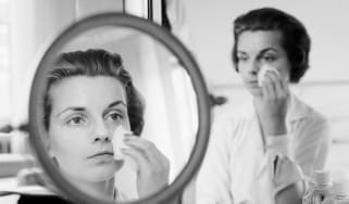 1950s woman removing make-up