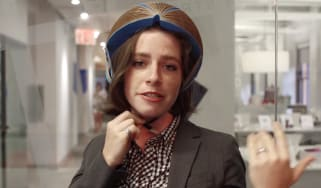 Isis Shiffer modelling her paper helmet