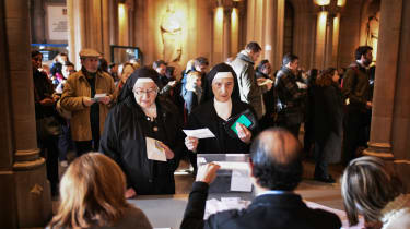 Nuns cast their ballot papers at a polling station in Barcelona