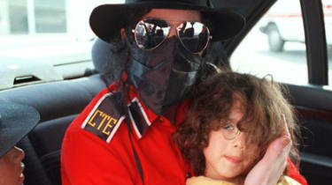 Michael Jackson with an unidentified boy in 1993