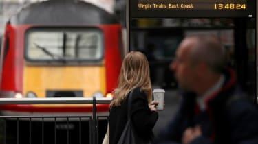 A Virgin Trains East Coast line service departs at London's Kings Cross