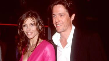 """370137 01: FILE PHOTO: Elizabeth Hurley and Hugh Grant attend the premiere of """"Mickey Blue Eyes"""" August 17, 2000 in Westwood, CA. The couple of 13 years have decided to call it quits May 23,"""