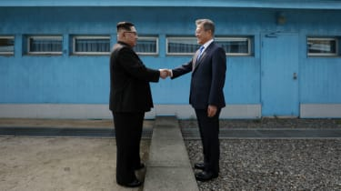 Kim Jong Un shakes hands with South Korea's President Moon Jae-in