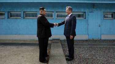 Kim Jong Un shakes hands with South Korea's President Moon Jae-in