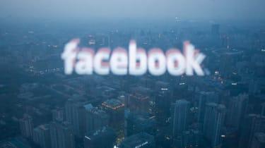 The Facebook logo reflected over the Beijing skyline