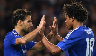 Cesc Fabregas and Loic Remy of Chelsea