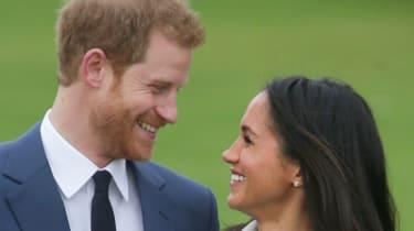Prince Harry and Meghan Markle pose at Kensington Palace