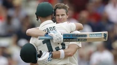 Australia batsman Steve Smith celebrates his century with team-mate Matthew Wade