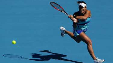 HOBART, AUSTRALIA - JANUARY 11:Heather Watson of Great Britain plays a backhand in her first round doubles match with Ajia Tomljanovic of Croatia against Monique Adamczak and Olivia Rogowska