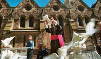 Archbishop of Adelaide Philip Wilson releases white doves with schoolchildren in 2002