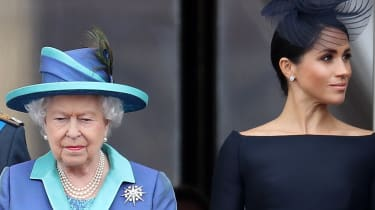 Queen Elizabeth II and Meghan, Duchess of Sussex on the balcony of Buckingham Palace
