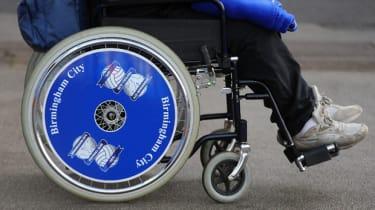 A wheelchair-bound person