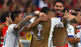 Arturo Vidal of Chile celebrates victory over Spain with his teammates